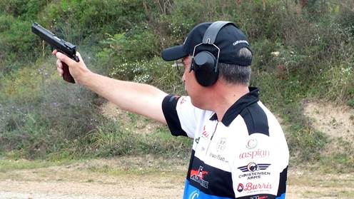 2015 NRA World Shooting Champion Bruce Piatt shooting bullseye pistol